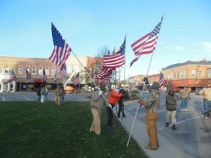 Residents of Fairfield construct an avenue of flags around the town square in honor of Veterans Day.