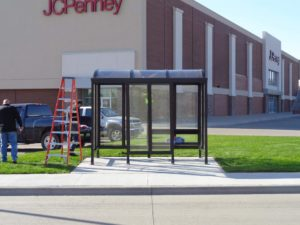 Westdale Mall management purchased and installed a new bus stop shelter this week. The new shelter, which is handicap accessible and includes a wind screen and bench, replaces a makeshift area used for the past several months as the mall underwent significant redesign and construction. (Submitted photo)