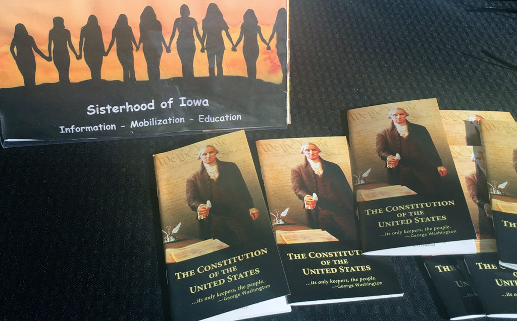 Four Iowa women founded the Sisterhood of Iowa last year shortly after the inauguration of President Donald Trump. They aim to better educate the public about the U.S. Constitution and have pooled personal funds to buy copies, which they give away. The copies shown here were distributed at the Women's March in Des Moines on Jan. 20, 2018.