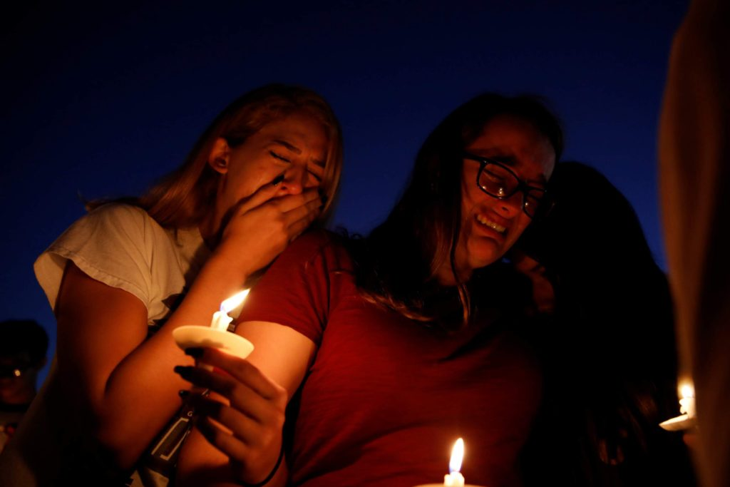 Gun Violence - Students mourn during a candlelight vigil for victims of yesterday's shooting at nearby Marjory Stoneman Douglas High School, in Parkland, Florida, February 15, 2018.