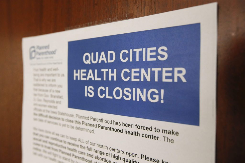 A notice is posted June 26, 2017, in the bathroom at Planned Parenthood of the Heartland's Quad Cities Health Center in Bettendorf. The Quad Cities clinic closed due to a state program targeting family planning facilities that offer abortion services.