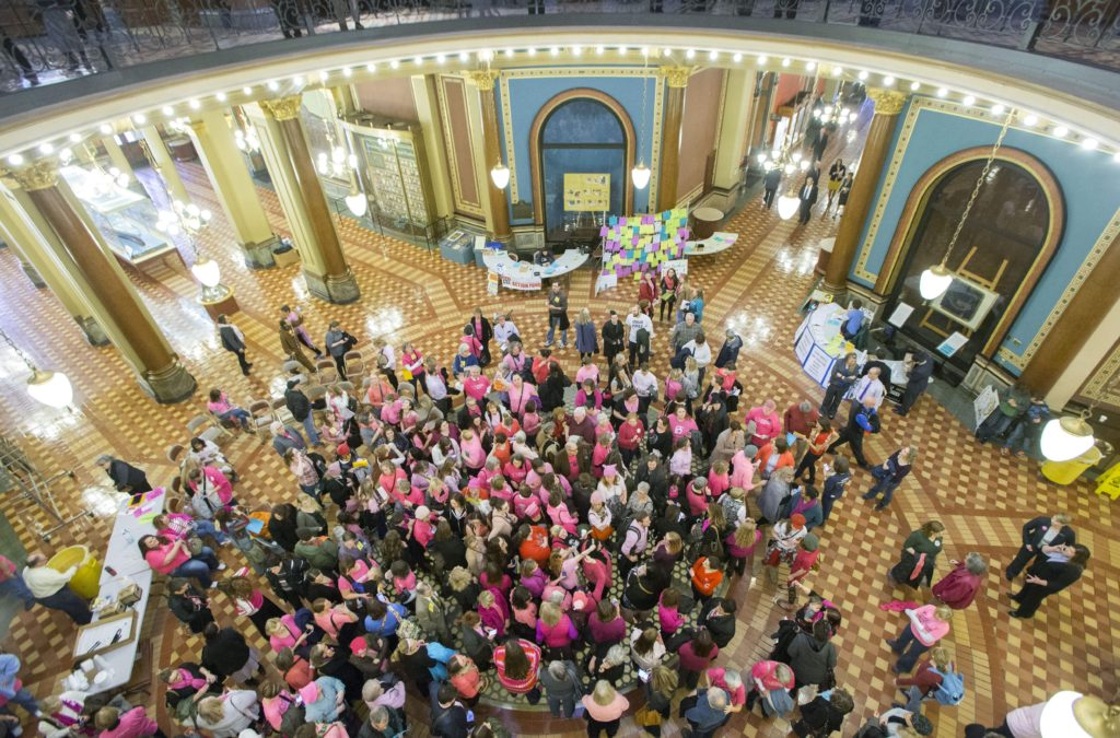 Planned Parenthood supporters gather Jan. 24, 2017, in the rotunda of the Iowa Capitol following a Senate subcommittee hearing on a bill to create a state-run organization denying funding for health providers that also offer abortion services.