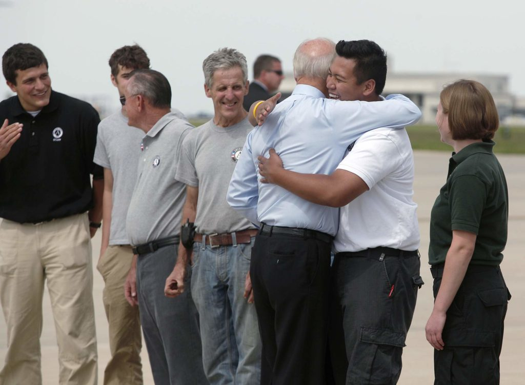 An Americorps volunteer receives a hug from Vice President Joe Biden before he boarded Air Force Two after speaking at a campaign rally on May 18, 2010 in Cedar Rapids, Iowa.